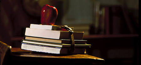 school books with an apple