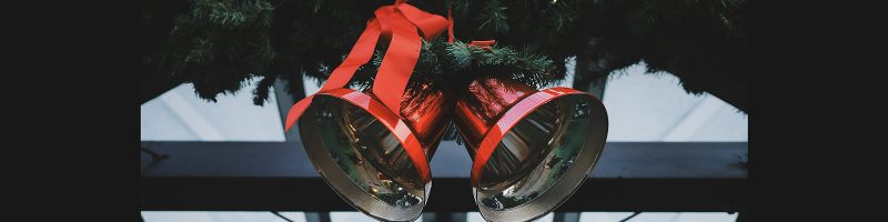 Two Christmas bells with red ribbon
