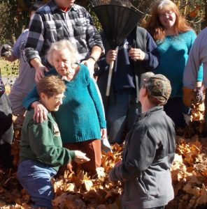 Group of people standing in a pile of leaves