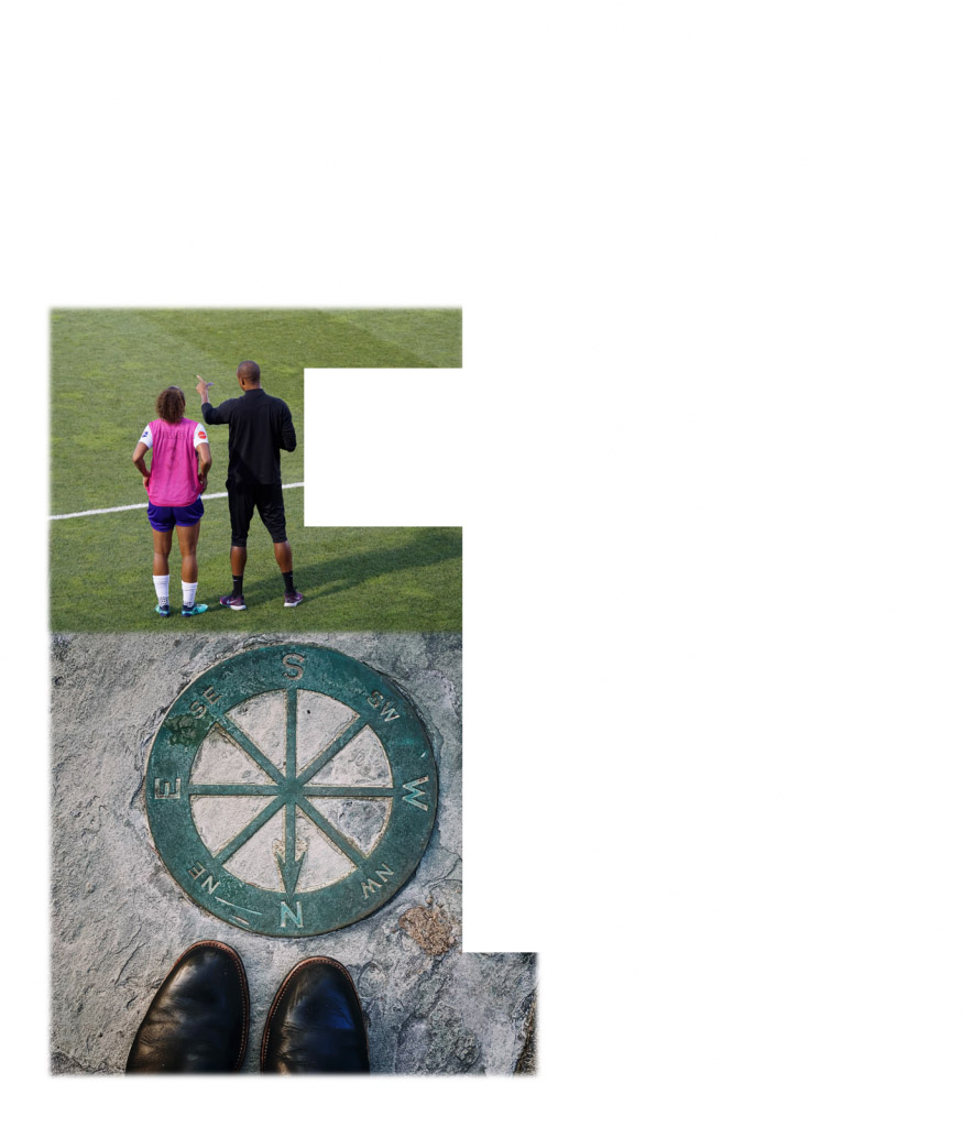 coach and player on soccer field; shoes near a compass